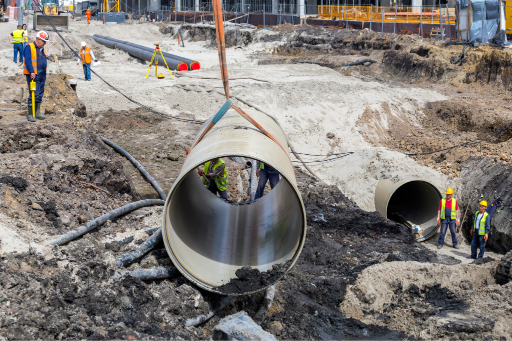 BELGRADE, SERBIA - MARCH 31, 2018: Big Diameter FRP pipe installation, Fiberglass Reinforced Plastic pipe reduces the size of the lifting equipment required, lowering installation costs.