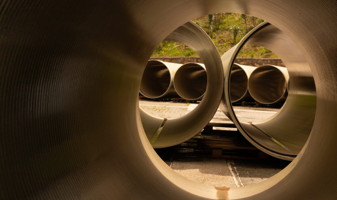 FRP (GRP) pipes are waiting in the field for installation